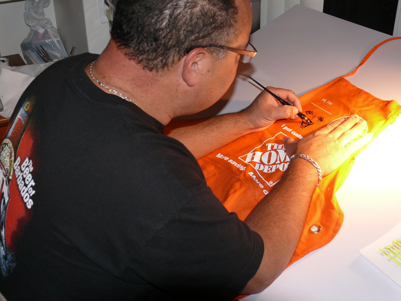 Bruce working late caricaturing the aprons