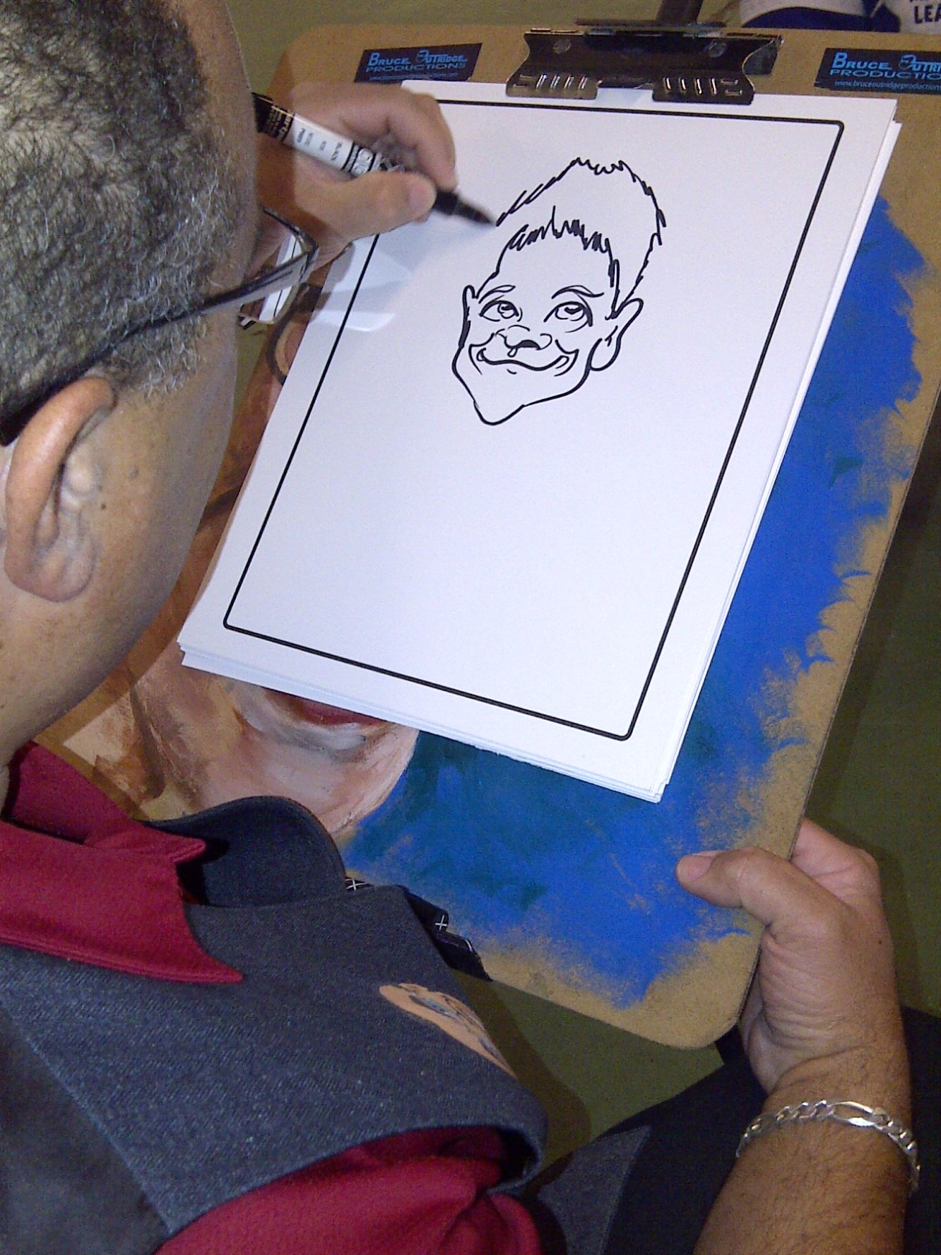 Bruce Drawing a Caricature
