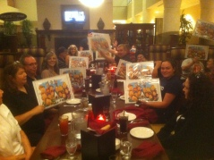 Gang holding up caricatures