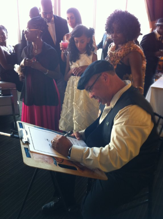 Bruce drawing caricatures at event